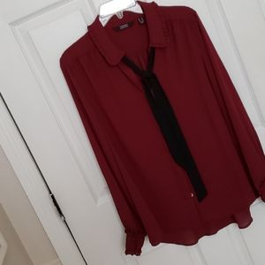 Dennis basso neck bow in a merlot color blouse.